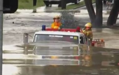 Fire truck drives through 11ft flood