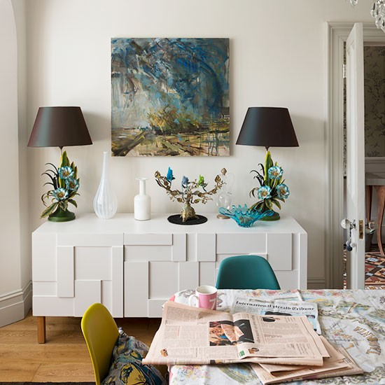 Modern-white-dining-room-with-sideboard-and-teal-accents.jpg