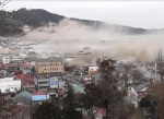 津波に襲われている元の街並み